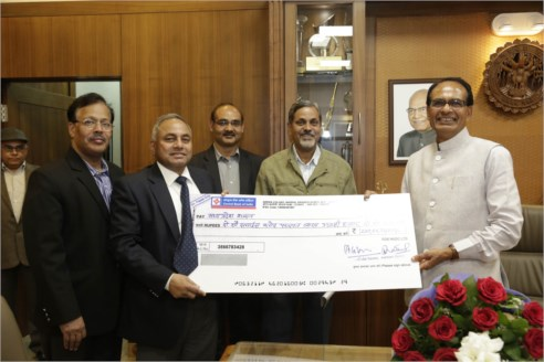 NHDC hands over dividend cheque to CM Chouhan