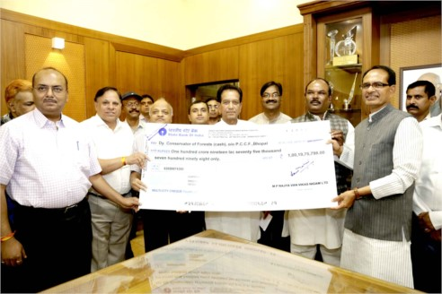 Dividend cheque of Forest Development Corporation given to CM